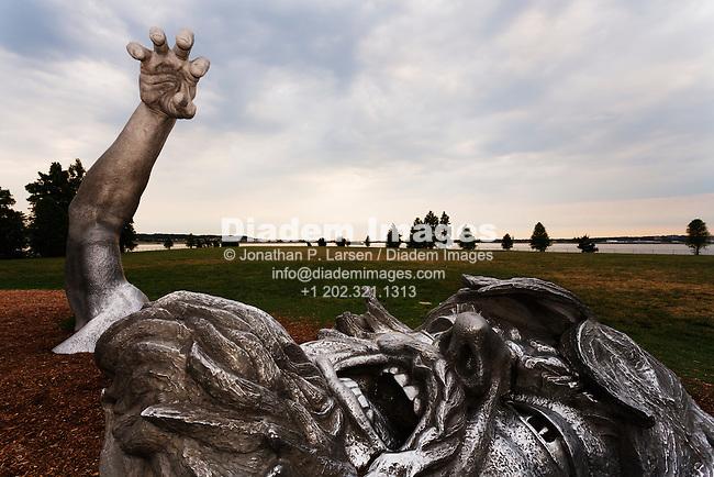 The Awakening sculpture by J. Seward Johnson, Jr. - 2007, Hains Point, Washingon, DC.