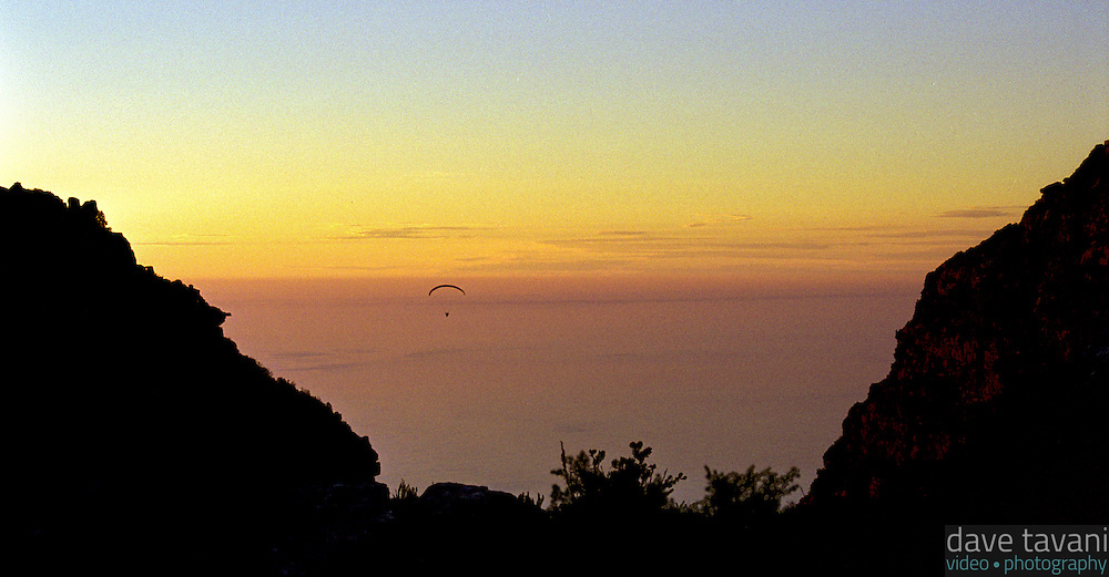 A hang glider floats above Table Bay, as seen from Table Mountain in Cape Town, South Africa.