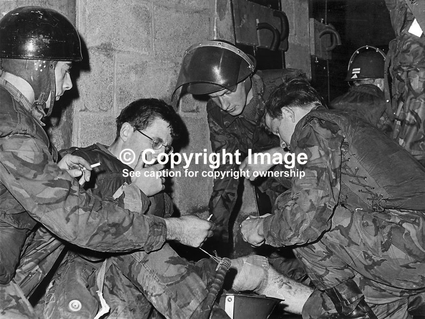 Corporal Peter Booth, Royal Green Jackets, gets immediate medical attention after being shot in the knee in the Bogside, Londonderry, N Ireland. The incident was one of three shooting incidents when a total of 15 shots were fired at British soldiers following an earlier civil rights meeting. 197107270777a..© Victor Patterson, 54 Dorchester Park, Belfast, N Ireland. Tel: +44 2890661296; Mobile: +44 7802 353836; Emails: victorpatterson@me.com & victorpatterson@gmail.com; www.victorpatterson.com