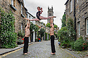 Edinburgh, UK. 04.08.2016. Members of Australian circus troupe, Circa, limber up in Circus Lane, Stockbridge, ahead of their run at the Underbelly, as part of the Edinburgh Festival Fringe. L to r: Daniel O'Brien, Lauren Herley, Jarred Dewey. Photograph © Jane Hobson.