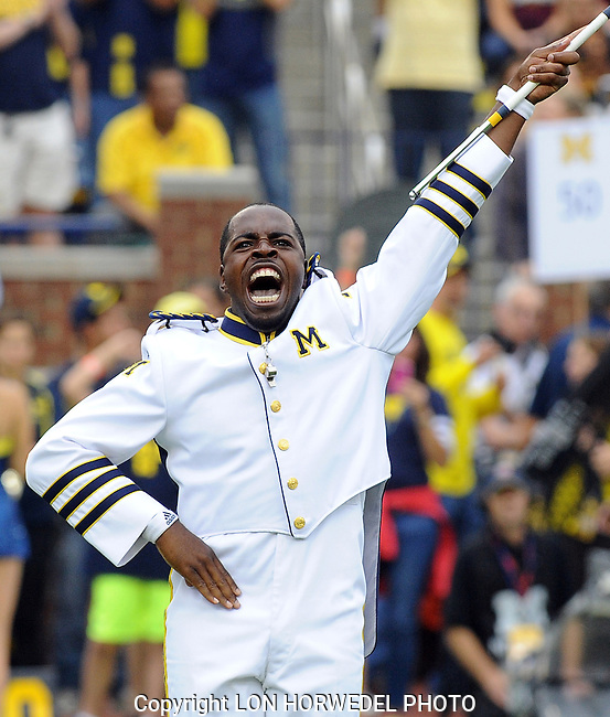 Saturday, October 5, 2013: University of Michigan Marching Band drum major Jeffrey Okala fires up the crowd during the band's pre-game show before UM's clash with Minnesota in both team's Big Ten opener, Saturday at Michigan Stadium.