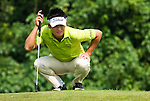HAIKOU, CHINA - OCTOBER 30:  Ryuji Imada of Japan lines up a putt on the 5th green during day four of the Mission Hills Start Trophy tournament at Mission Hills Resort on October 30, 2010 in Haikou, China. The Mission Hills Star Trophy is Asia's leading leisure liflestyle event and features Hollywood celebrities and international golf stars.  Photo by Victor Fraile / The Power of Sport Images