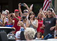 NWA Democrat-Gazette/BEN GOFF @NWABENGOFF<br /> Family of Chuck Hurl, a U.S. Army World War II veteran from Bella Vista, stand as Hurl is introduced as the parade's grand marshall Thursday, July 4, 2019, during the Bella Vista Patriots Parade at Sugar Creek Shopping Center.