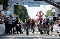 Tim Merlier (BEL/Corendon - Circus) crosses the finish line first; winning the bunch sprint and the Belgian National Champions Title<br /> <br /> Belgian National Road Championships 2019 - Gent<br /> <br /> ©kramon