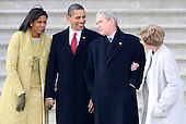 Washington, DC - January 20, 2009 -- (L-R) Michelle Obama, United States President Barack Obama, Former President George W. Bush and Laura Bush share a laugh as they wait to wave goodbye as former Vice President Dick Cheney departs on the East Front of the US Capitol Building after Barack Obama was sworn in as the 44th President of the United States in Washington, DC, USA 20 January 2009.  Obama defeated Republican candidate John McCain on Election Day 04 November 2008 to become the next U.S. President..Credit: Tannen Maury - Pool via CNP