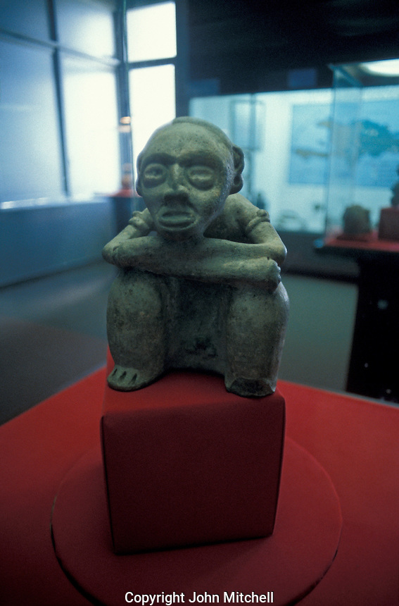 Taino (Arawak) stone carving of a seated man in the  Museum of the Dominican Man or Museo del Hombre Dominicano in Santo Domingo, Dominican Republic