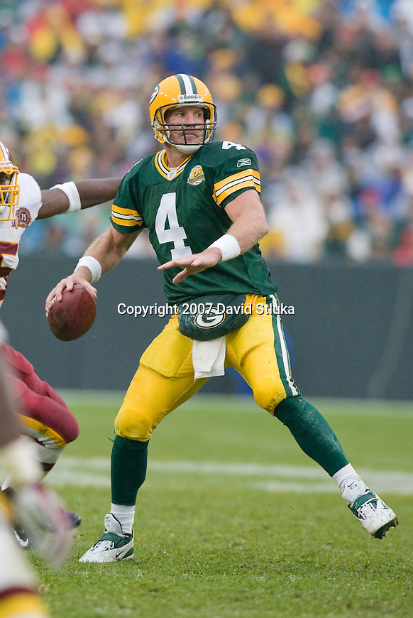 Quarterback Brett Favre #4 of the Green Bay Packers looks for a receiver during an NFL football game against the Washington Redskins at Lambeau Field on October 14, 2007 in Green Bay, Wisconsin. The Packers beat the Redskins 17-14. (Photo by David Stluka)