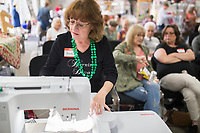 NWA Democrat-Gazette/CHARLIE KAIJO Rhonda Guinn, instructor at the Rogers Sewing Center, uses a Bernina sewing and embroidery machine, Friday, March 16, 2018 at the Rogers Sewing Center in Rogers. The advanced machines can be programmed with digitized patterns to create different designs.<br /><br />The Oklahoma Embroidery Supply &amp; Design hosted an informational class where participants learned about embroidery tips and techniques. About 40 people attended the day's event. The event will continue on Saturday from 10-4pm