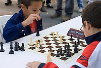 Spain, Canary Islands, La Palma, Los Llanos de Aridane: Calle Real (former Calle General Franco), street festival, kids playing chess
