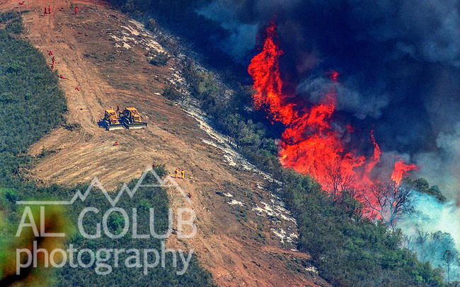 August 17, 1992 Angels Camp, California -- Old Gulch Fire—Firebreak contains fast-moving fire near Old Gulch Road.   The Old Gulch Fire raged over some 18,000 acres, destroying 42 homes while threatening the Mother Lode communities of Murphys, Sheep Ranch, Avery and Forest Meadows.