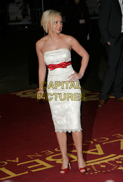 "CHANELLE HAYES.UK Premiere of ""Elizabeth - The Golden Age"" at the Odeon Leicester Square, London, England, October 23rd 2007..full length white strapless dress lace red shoes hand on hip.CAP/AH.©Adam Houghton/Capital Pictures."