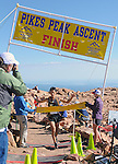 August 15, 2015 - Manitou Springs, Colorado, U.S. - Japan's Touru Miyahara crosses the finish line in 2:15:42 to win the Pikes Peak Ascent during the 60th running of the Pikes Peak Ascent and Marathon.  During the Ascent, runners cover 13.3 miles and gain more than 7815 feet (2382m) by the time they reach the 14,115ft (4302m) summit.  On the second day of race weekend, 800 marathoners will make the round trip and cover 26.6 miles of high altitude and very difficult terrain in Pike National Forest, Manitou Springs, CO.