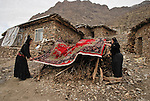 25/12/09 -- Zeuke village, Iraqi Kurdistan, Iran-Iraq border.  Women from the village lay a rug to dry outside their house.
