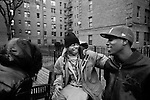 "BROOKLYN -- FEBRUARY 07, 2009:  Rapper Equan ""Aimz"" Jones, 19, sits on a bench with his cousin (L) and friend ""Play"" (R) in a courtyard at the Vanderveer Estates apartment complex on February 07, 2009 in Brooklyn. (PHOTOGRAPH BY MICHAEL NAGLE)."