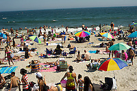 Beachgoers escape the heat wave at Rockaway Beach in the Queens borough of New York on Saturday, June 30, 2012 during the long Fourth of July weekend.  (© Frances M. Roberts)