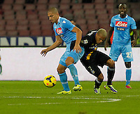 Gokhan Inler  fight with  Jonathan Biabiany during the Italian Serie A soccer match between SSC Napoli and Parma FC at San Paolo stadium in Naples