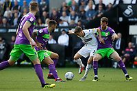 Tom Carroll of Swansea City (C) challenged by Marley Watkins of Bristol City (R) during the Sky Bet Championship match between Swansea City and Bristol City at the Liberty Stadium, Swansea, Wales, UK. Saturday 25 August 2018