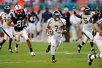 29 November 2008:  FIU defensive back Anthony Gaitor (7) runs to the end zone after scooping up a loose ball in the FAU 57-50 overtime victory over FIU in the annual Shula Bowl at Dolphin Stadium in Miami, Florida.  Upon review, the play was called an incomplete pass rather than a fumble.