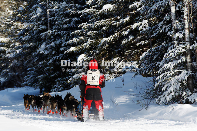 DULUTH, MN - JANUARY 30:  Musher Colleen Wallin competes on day 1 of the 2011 John Beargrease Sled Dog Marathon on January 30, 2011 in Duluth, Minnesota.