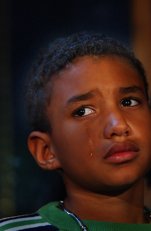 A tear rolls down the face of Michael Chambers during a press conference about the Independence Day weekend killing of his mother Virginia Alvarez at Parker Center in downtown L.A.