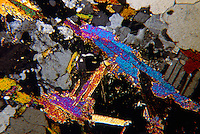 QUARTZ (SiO2): 50x mag of crystal slice<br /> Polarized light<br /> Essential constituent of Igneous rocks- granite, rhyolite, and pegmatite. Metamorphic- major constituent of  gneiss and schist; quartzite is almost entirely quartz. Sedimentary-  veins in limestone, main component of sandstone.