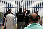 Israeli border police detain a Palestinian youth trying to cross to Jerusalem's al-Aqsa mosque, at the Qalandia Israeli checkpoint, betweeen Jerusalem and the West Bank city of Ramallah, May 25, 2019. The Israeli authorities reportedly banned Palestinian men under the age of 40 from entering East Jerusalem, although women were allowed in. Photo by Ayat Arqawy