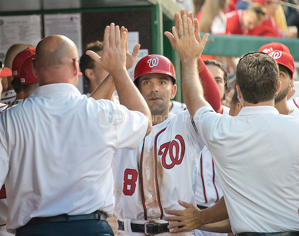 Washington Nationals shortstop Danny Espinosa (8) is congratulated by teammates after scoring the tying run in the bottom of the twelfth inning against the Chicago Cubs at Nationals Park in Washington, D.C. on Wednesday, June 15, 2016.  The Nationals won the game 5 - 4 in 12 innings.<br /> Credit: Ron Sachs / CNP/MediaPunch ***FOR EDITORIAL USE ONLY***