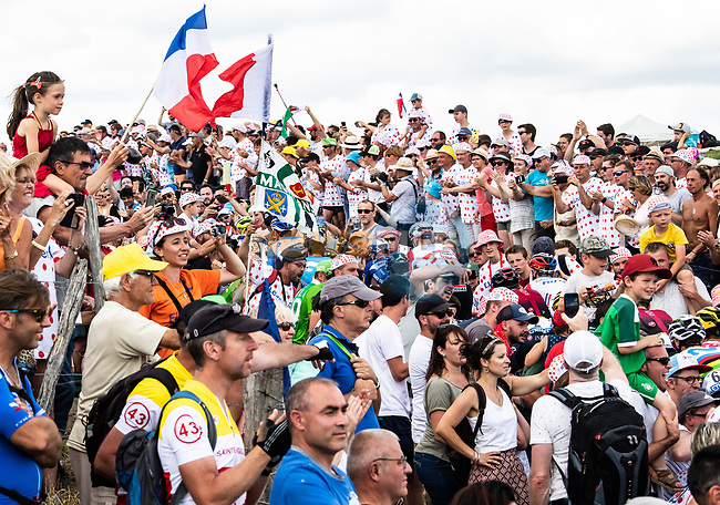 The peloton lost amidst the huge crowd climb the Cote de Saint-Just during Stage 9 of the 2019 Tour de France running 170.5km from Saint-Etienne to Brioude, France. 14th July 2019.<br /> Picture: ASO/Alex Broadway | Cyclefile<br /> All photos usage must carry mandatory copyright credit (© Cyclefile | ASO/Alex Broadway)