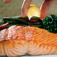 SQUEEZING LEMON ON SALMON<br /> Lemon Contains Citric Acid