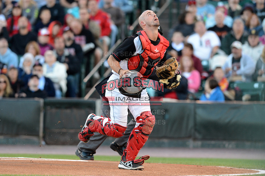 Rochester Red Wings catcher Eric Fryer (19) looks for a pop up in foul territory during an International League playoff game against the Pawtucket Red Sox on September 5, 2013 at Frontier Field in Rochester, New York.  Pawtucket defeated Rochester 7-2.  (Mike Janes/Four Seam Images)