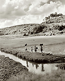 MADAGASCAR, women walking amid rice fields, outskirts of Antananarivo (B&W)