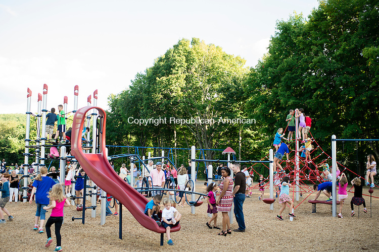 SOUTHBURY, CT - 24 September 2015-092415EC03-- The Pomperaug Elementary School PTO celebrated the unveiling of a new playground Thursday in Southbury. Dozens of children played on the new playscape, which coincided with the annual back to school picnic. Erin Covey Republican-American.