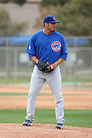 Matt Garza #17 of the Chicago Cubs participates in pitchers fielding practice during spring training workouts at the Cubs complex on February 19, 2011  in Mesa, Arizona. .Photo by Bill Mitchell / Four Seam Images.