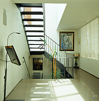 The entrance hall and stairwell are lit by a large skylight situated in the roof above