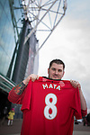 © Joel Goodman - 07973 332324 . 27/01/2014 . Manchester , UK . KYLE GOLDSWORTHY (26) (correct)  from Bristol poses with his new shirt in front of Old Trafford . He is in Manchester for the Cardiff match tomorrow . Fans with new MATA 8 shirts in front of Old Trafford Football Ground as it's announced that Spaniard Juan Mata ( Juan Manuel Mata García ) has signed for Manchester United  . Photo credit : Joel Goodman