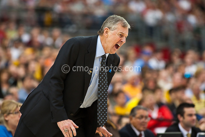Mar 28, 2009; Glendale, AZ, USA; Connecticut Huskies head coach Jim Calhoun yells at his team in the second half of a game against the Missouri Tigers in the finals of the west region of the 2009 NCAA basketball tournament at University of Phoenix Stadium.  The Huskies defeated the Tigers 82-75 to advance to the Final Four.
