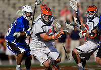 Brian McDermott (26) of Virginia takes possession of the ball out of the midfield during the ACC men's lacrosse tournament semifinals in College Park, MD.  Virginia defeated Duke, 16-12.
