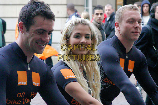 "GEMMA ATKINSON, with CHRIS HOY & JASON QUEALLY.Orange - official telecommunications partner of the Tour De France 2007 ? is giving away 500 mountain bikes and helmets worth £200 each, in support of its ""On Your Bike, London"" initiative. .Covent Garden, London, England, 4th July 2007..half length .CAP/ELI.©Matt Elliott/Capital Pictures."