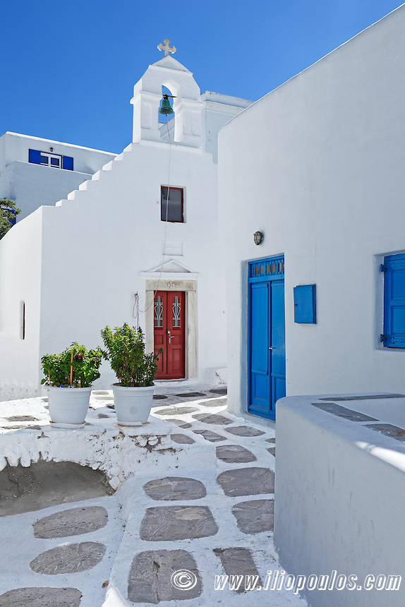 A small white chapel in an alley of Chora in Mykonos, Greece