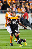 In anticipation for the ball Jermaine Taylor of the Dynamo grabs hold Lionard Pajoy of D.C United at BBVA Compass Stadium. Houston beat D.C United, 2-0 in the MLS season opener.