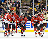 Garrett Vermeersch (Northeastern - 9), Vinny Saponari (Northeastern - 74), Braden Pimm (Northeastern - 14), Anthony Bitetto (Northeastern - 7) and Ludwig Karlsson (Northeastern - 45) celebrate Bitetto's goal. - The Boston College Eagles defeated the Northeastern University Huskies 7-1 in the opening round of the 2012 Beanpot on Monday, February 6, 2012, at TD Garden in Boston, Massachusetts.