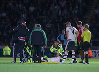 A concerned Fulham team tend to injured Jack Grimmer of Fulham during the Capital One Cup match between Wycombe Wanderers and Fulham at Adams Park, High Wycombe, England on 11 August 2015. Photo by Andy Rowland.