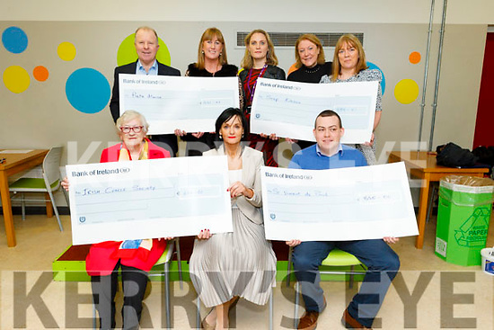 Four charities received cheques from the KCFE at the Clash Campus on Tuesday. <br /> Seated l to r: Chris Griffin (Irish Cancer Society, €646.25), Mary Lucey (Principal KCFE) and Paddy Devane (St Vincent de Paul, €850). Standing l to r: Con O'Connor (Pieta House, €446.43), Mary Galvin (Kerry College), Maria Brosnan, Mary Dowling, Colette Price (Soup Kitchen, €898.01).