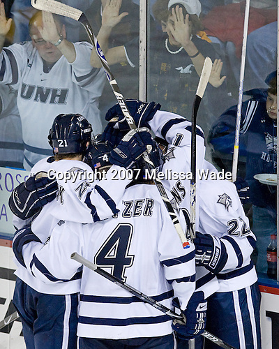 James van Riemsdyk (UNH - 21), Craig Switzer (UNH - 4), Brad Flaishans (UNH - 19), Mike Radja (UNH - 22) - The University of New Hampshire Wildcats defeated the Colorado College Tigers 4-2 on Saturday, October 27, 2007, at the Whittemore Center in Durham, New Hampshire.