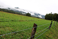 Stock photo: Cades cove hills covered in clouds as seen from a fence on the loop road in the great smoky mountain national park.