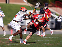 Rhamel Bratton (3) of Virginia checks Warren Hansen (40) of Maryland during the ACC men's lacrosse tournament finals in College Park, MD.  Virginia defeated Maryland, 10-6.