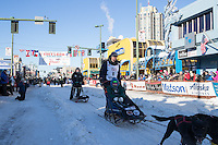 Ryan Anderson and team leave the ceremonial start line with an Iditarider and handler at 4th Avenue and D street in downtown Anchorage, Alaska on Saturday March 4th during the 2017 Iditarod race. Photo © 2017 by Brendan Smith/SchultzPhoto.com.
