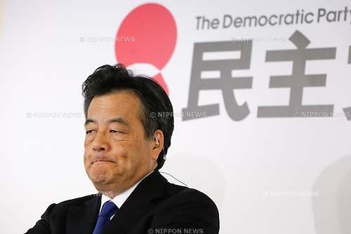 December 14, 2014, Tokyo, Japan - Katsuya Okada, acting president of the Democratic Party of Japan purses his lips as a mood of defeat prevails at the party headquarters in Tokyo while early returns from Sunday's general election indicate the ruling Liberal Democratic Party's landslide victory on December 14, 2014. The LDP will likely secure a majority in the parliament's lower chamber as voters gave Prime Minister Shinzo Abe a fresh mandate to forge ahead with his economic policy. (Photo by AFLO) UUK -mis-