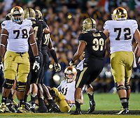 Tommy Rees sits on the field after being sacked in the first quarter.