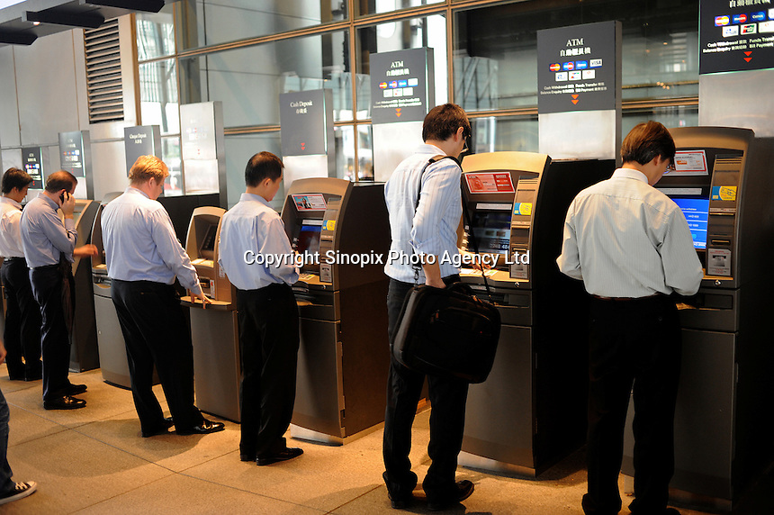 People using the ATM at the HSBC headquarter in Central, Hong Kong. HSBC is the world's largest company and the world's largest banking group, while it was named the world's most valuable banking brand by The Banker magazine in Feb 2008..